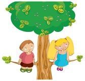 Boy and girl on the tree. Cute boy and girl sit on the high tree Stock Photo