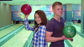 Boy and girl turn face to face at the bowling stock video footage