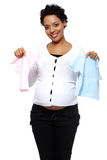 Boy, girl or twins. Pregnant woman holding two bodysuits for a baby (blue and pink royalty free stock photo