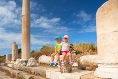Boy and girl twins visit ancient ruins in Side. Turkey stock images
