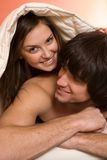 Boy with girl under blanket Stock Photography