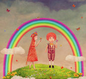 Boy and girl under the rainbow on a glade Stock Image