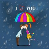 Boy and a girl under umbrella. Royalty Free Stock Image