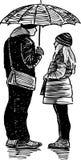 Boy and girl under umbrella Stock Photo