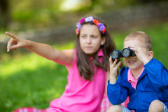 Boy and girl using binocular. Boy and girl exploring the environment with a binocular Stock Photography