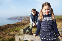 Boy And Girl Walking Along Coastal Path Royalty Free Stock Photography