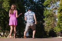 Boy Girl Walking Away Talking Laugh Royalty Free Stock Image