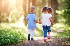 Boy and girl walking in the forest in summer Royalty Free Stock Images