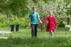 Boy with a girl walking in the park Royalty Free Stock Images