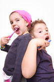 Boy and girl wash teeth Stock Images
