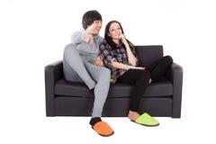 Boy and girl watch TV stock photos