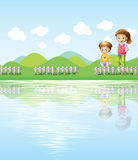 A boy and a girl watching the lake Royalty Free Stock Photography