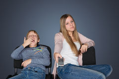 Boy and girl watching TV stock images