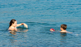 Boy and girl in water Royalty Free Stock Image