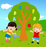 Boy and girl watering tree Royalty Free Stock Photos