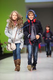 Boy and girl in wear from Snowimage on catwalk Royalty Free Stock Photos