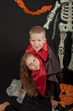 The boy and girl wearing halloween costumes Royalty Free Stock Photography