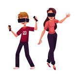 Boy and girl wearing virtual reality headsets, simulators, playing together Stock Photography