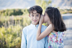 Boy and girl whispering Royalty Free Stock Photography