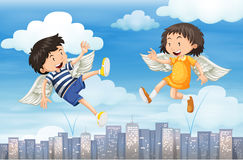 Boy and girl with wings flying in the sky Royalty Free Stock Images