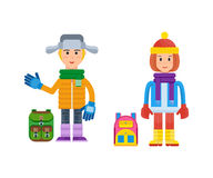 Boy and girl in winter clothing prepared for cold weather. Royalty Free Stock Image