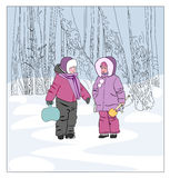 A boy and a girl in winter on a walk. Royalty Free Stock Image