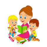 Boy, girl and woman are reading a book Stock Photography