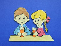 Boy and girl, wood carving. Girl and boy drinking cocktail, wood carving Stock Photo