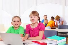 Boy and girl working together Royalty Free Stock Photo
