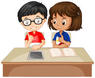 Boy and girl working together Royalty Free Stock Images