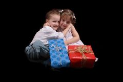 Boy, girl and xmas presents Royalty Free Stock Photo