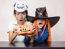 Boy and girl yelling shocked at Halloween Stock Image