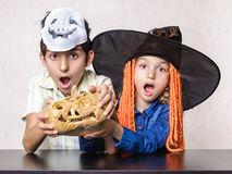 Boy and girl yelling shocked at Halloween Royalty Free Stock Photo