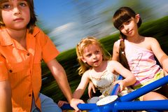 Boy and girls on carousel Royalty Free Stock Photography
