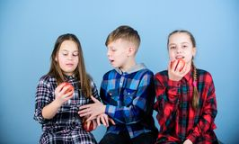 Boy and girls friends eat apple. Teens with healthy snack. Group teenagers cheerful kids hold apples. Healthy dieting. And vitamin nutrition. Eat fruit and be stock images