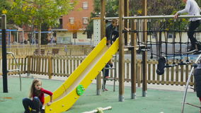 boy and girls having fun on slide stock video footage