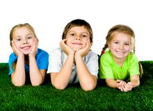 Boy and girls lying on a green grass Stock Photo