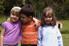 Boy and girls playing Stock Photography