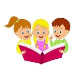 Boy and girls read book Stock Photos