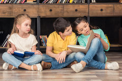 Boy and girls reading books Royalty Free Stock Photography