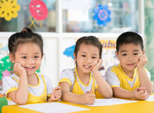 Boy and girls sitting in the kindergarten Stock Photo