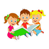 Boy and girls sitting reading a book Stock Photos