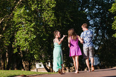 Boy Girls Walking Away Talking Laugh Royalty Free Stock Image