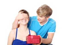 Boy give a gift to his girlfriend. Royalty Free Stock Photos