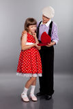 The boy gives beads to the girl. Retro style. Royalty Free Stock Photography