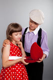 The boy gives beads to the girl. Retro style. Royalty Free Stock Image