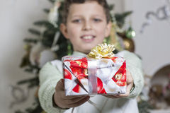 Boy gives Christmas gift Stock Photography
