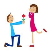 Boy gives a flower to the girl Stock Images