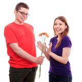 The boy gives flowers to a girl Royalty Free Stock Images