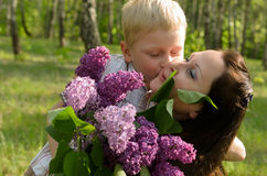 The boy gives flowers to his mother.  royalty free stock images